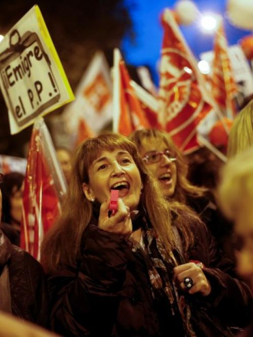 Demonstrators take part in a march during a 24-hour nationwide general strike in central Madrid,...