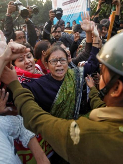 Demonstrators vent their anger during a protest in Kolkata in support of a woman who died...