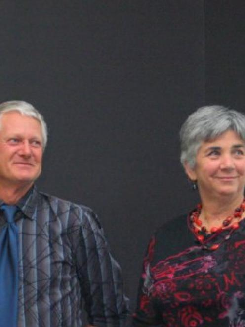 Dennis and Margaret Larsen during a presentation at the New Zealand Farm Forestry Association...