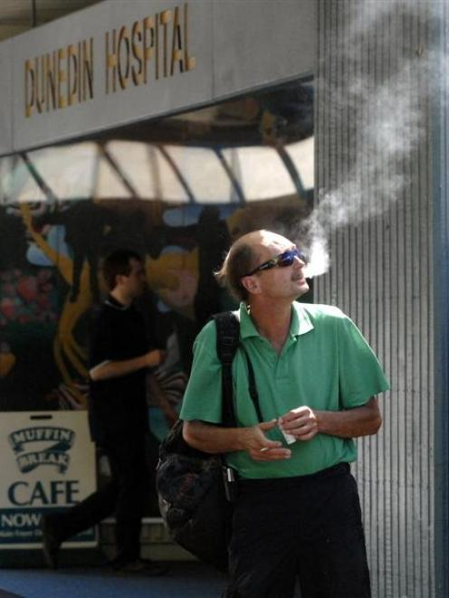 Dennis Leitch, of Alexandra, smokes outside Dunedin Hospital yesterday while he waits for a...
