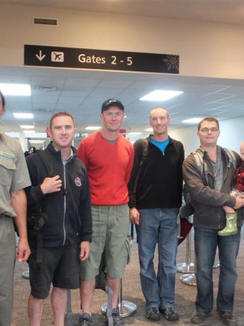 Department of Conservation firefighters leaving Queenstown yesterday for Melbourne, to help fight...