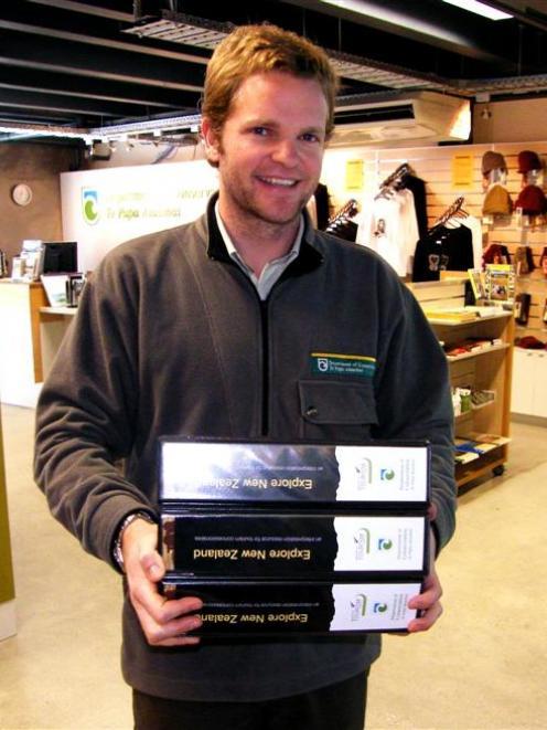 Department of Conservation Queenstown Regional Visitor Centre supervisor Andrew Evans inside the ...