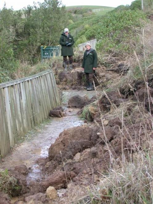 Department of Conservation rangers Helen Jones (left) and Kevin Pearce assess damage to the Bushy...