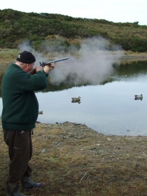 Derek Barrett (above and at right) gives his 140-year-old gun an airing during duck-shooting....