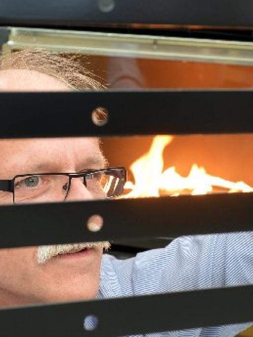 Design enthusiast Mark Cowden, pictured checking fire curtains during production at Escea, is...