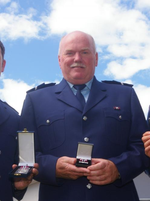 Detective Constable Robin Hutton (left), of Balclutha, Senior Constable Richard Whitmore, of...