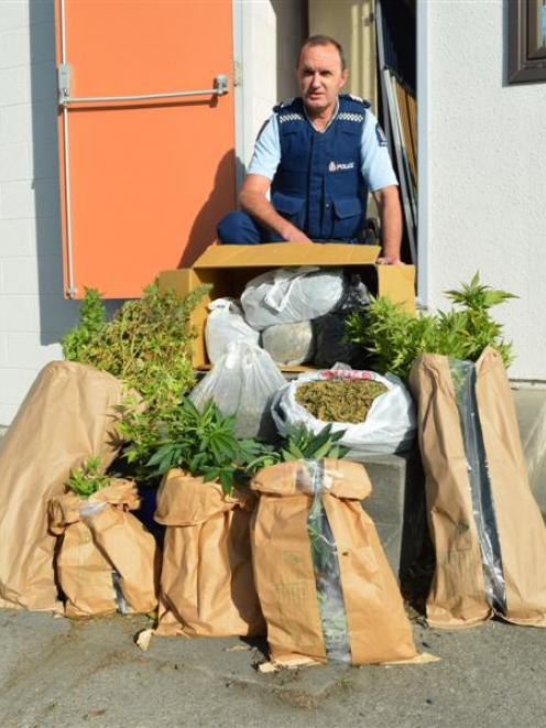 Detective Sergeant Stan Leishman, who is relieving in Balclutha, with the cannabis recovered from...