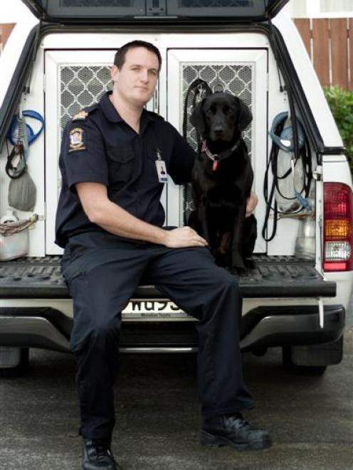 Detector dog Kane and his handler Senior Customs Officer Robert Gillanders. Photo by New Zealand...