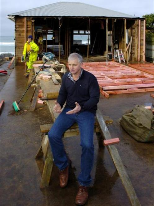 Developer Stephen Chittock with workmen assembling wall framing for a new cafe and bar at the...