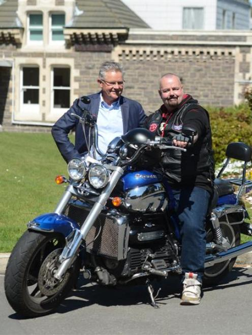 Diabetes trial patient Shane Solomon on his Triumph Rocket III, with cardiologist Gerry Wilkins....
