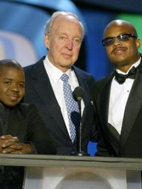 Diff'rent Strokes actors (L to R) Gary Coleman, Conrad Bain and Todd Bridges speak on stage...