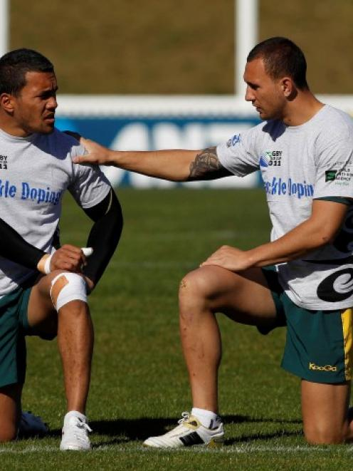 Digby Ioane (L) with Quade Cooper at a Wallabies training session. Photo: REUTERS/Brandon Malone