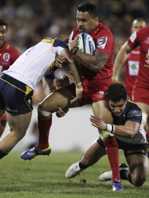 Digby Ioane of the Reds is tackled during the round 1 Super Rugby match between the Brumbies and...