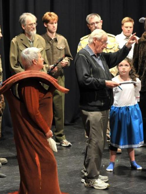 Director Bert Nisbet explains his vision with part of the cast of Grimhilda! during a rehearsal...