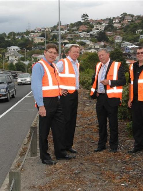 Discussing the improvements to the Caversham highway are (from left) Opus International project...