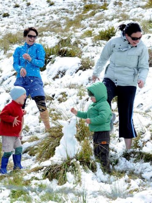 Dodging snowballs on the Crown Range yesterday are Rachel Shirley (left) and her son Ethan...