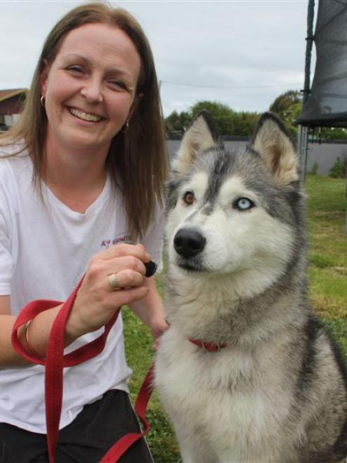 Dog aromatherapist Jo Thomas, of Wallacetown, near Invercargill, prepares to treat  her 6-year...