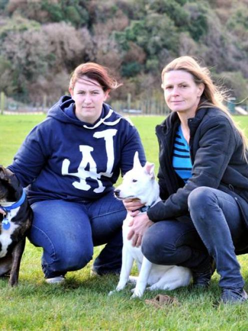 Dog Rescue Dunedin handler Anna Broad (left) and co-ordinator Jo Pollard, with rescued dogs Rosie...