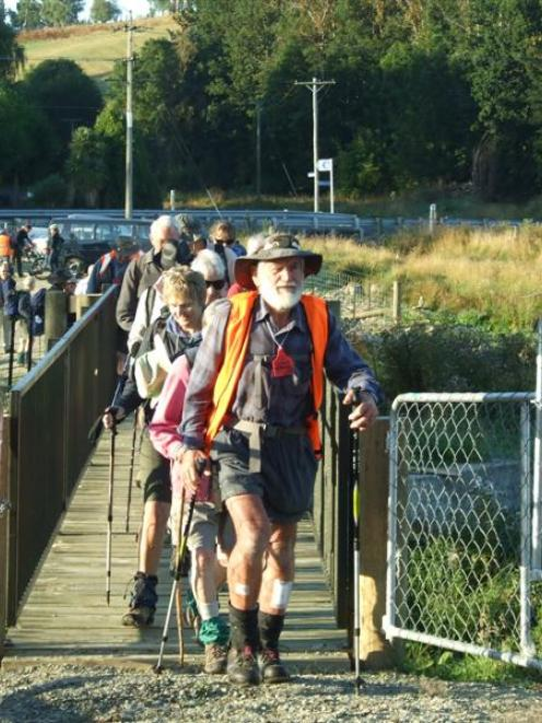 Don Morrison leads the Otago Goldfields Cavalcade 'Whisky Galore' walking trail on to the...