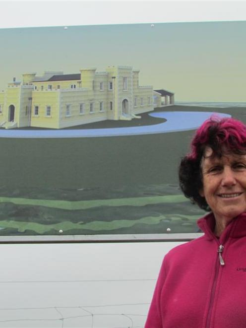 Dot Smith with an artist's impression of what her new home will look like. Photo by Andrew Ashton.