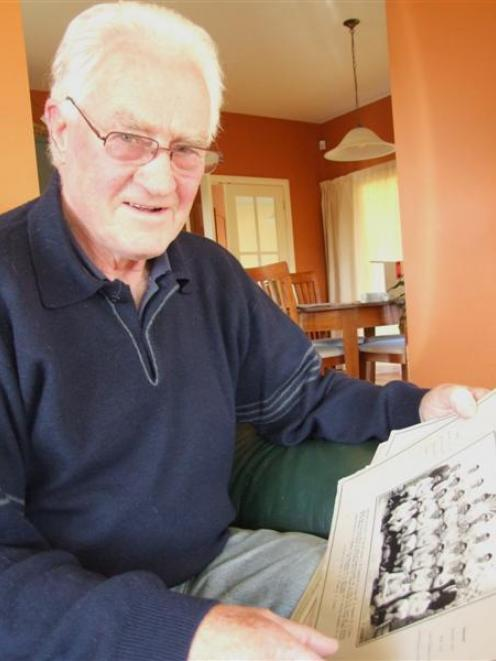 Doug Grant looks over some of his old rugby photographs at his Oamaru home yesterday. Photo by...