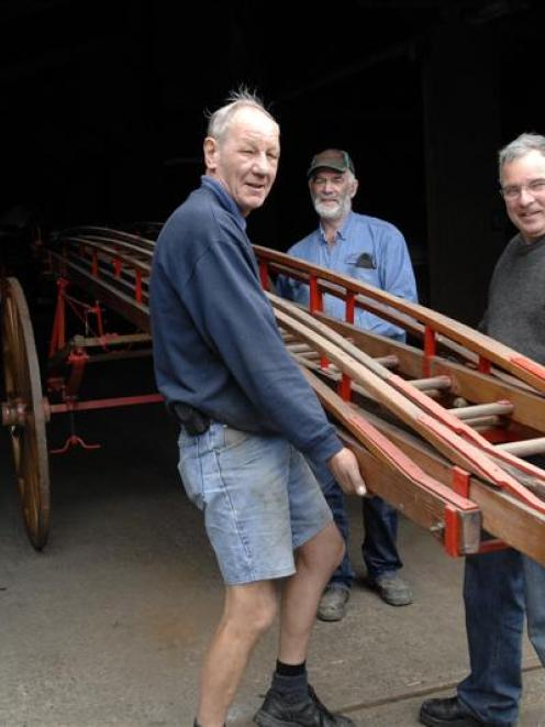 Doug Hall (right, rear), the owner of Hall Brothers Transport Ltd, helps Dunedin Fire Brigade...