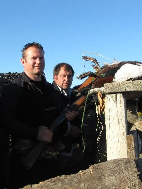 Doug Reid (left), of Queenstown, and Geoff McAtamney, of Lauder, scan the skies for ducks on Mr...