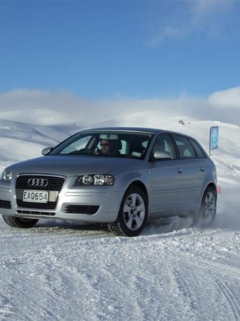 Downforce instructor Tim Martin slides an Audi RS4 expertly around a corner at the Ice Drive at...