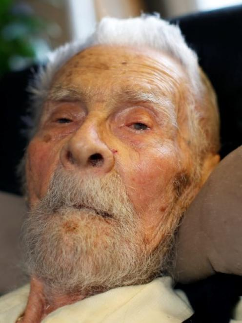 Dr Alexander Imich, the world's oldest living man, poses for a photograph during an interview...