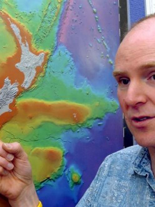 Dr Andrew Gorman indicates the Alpine Fault. Photo: ODT files.