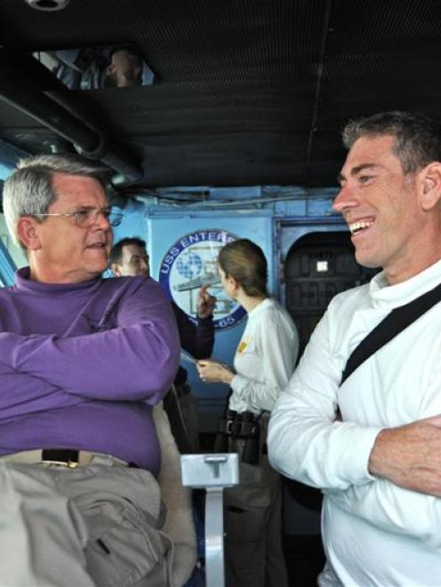 Dr Dave McKay (right) talks  to Captain William Hamilton on the  USS Enterprise bridge. Photo...