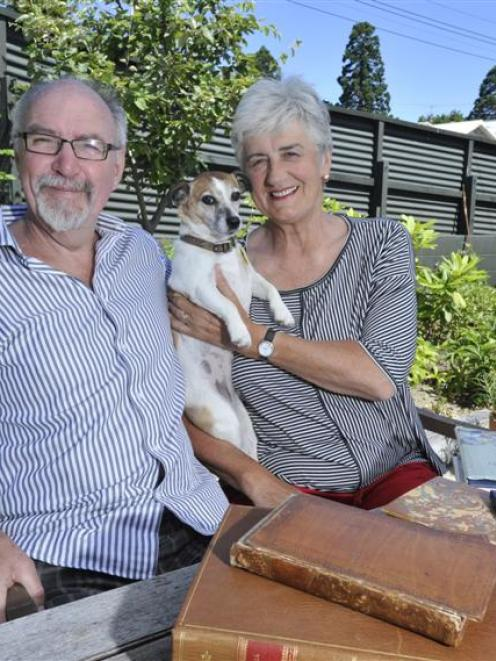 Dr David Galloway and wife Patricia Payne with their dog Lily at home in Dunedin yesterday. Photo...