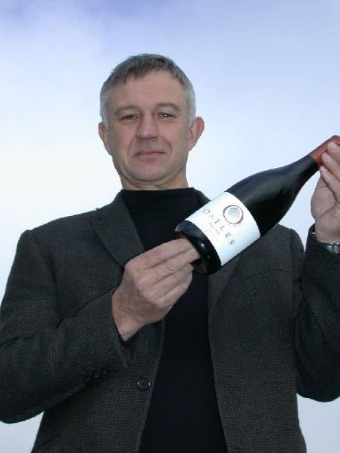 Dr Jim Jerram in 2007 with Ostler Vineyard's first pinot noir, from its vineyard in the lower...