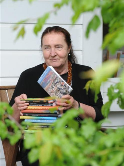 Dr Jindra Ticha at home in Dunedin with some of her published books. Photo by Nigel Benson.