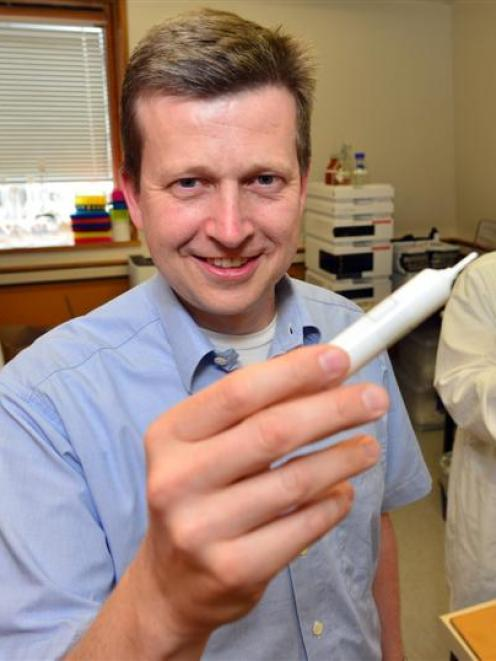 Dr Olaf Bork (front) works on mastitis research in the laboratory at the University of Otago's...