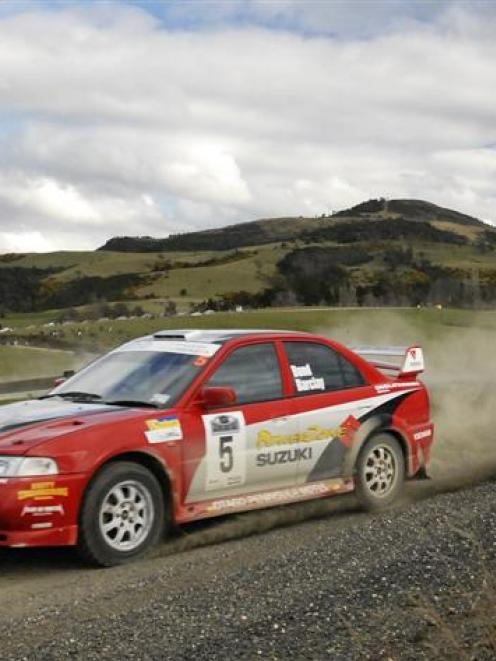 Driver Dean Bond and co-driver Craig Barclay, of Balclutha, in their Mitsubishi Evo 6.5 during ...