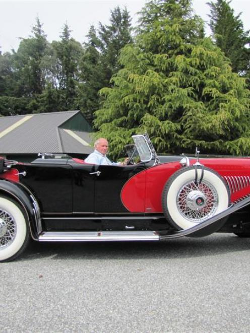 Duesenberg ''caretaker'' Robert Duncan at the wheel of the latest addition to the collection at...