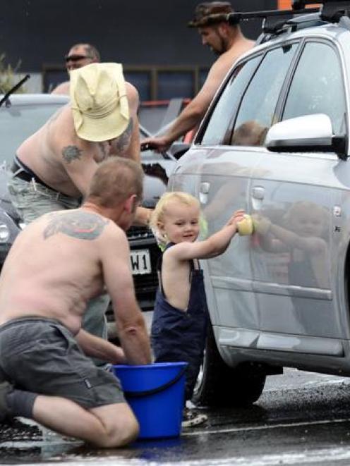 Dunedin 17-month-old Jack McKenzie scrubs in alongside Kevin Moylan (left) and Glen Stapley ...