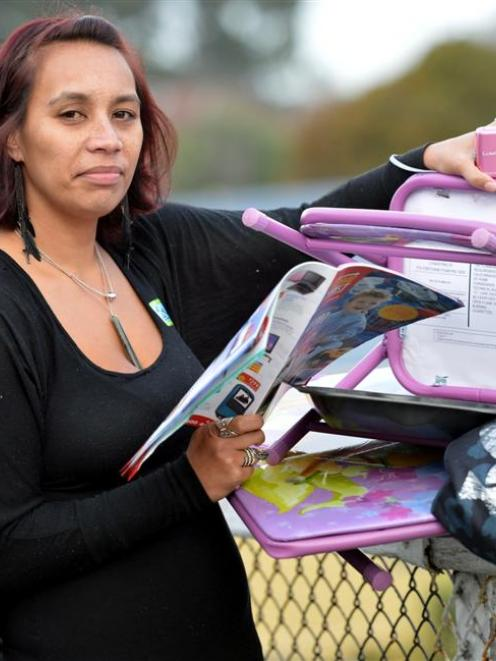 Dunedin beneficiary Axelina Pokipoki with a Home Direct brochure and products which increased her...