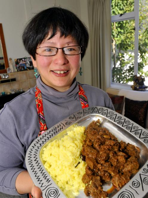 Dunedin chef Karen Khoo, originally from Singapore, with her dish of beef rendang. Photo by...