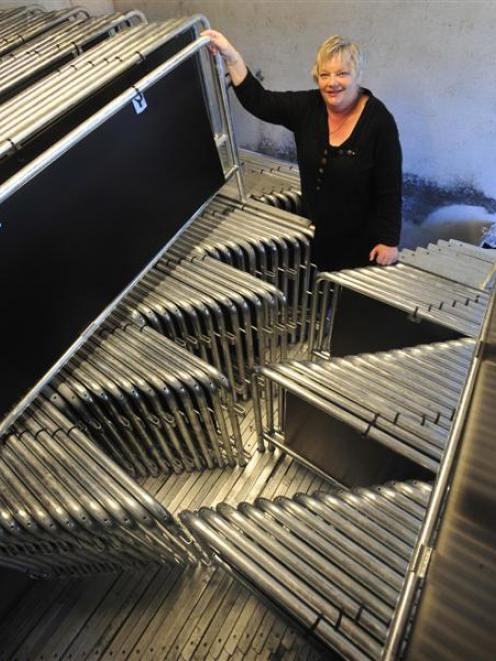 Dunedin City Council events team leader Marilyn Anderson with a batch of new barrier fences which...