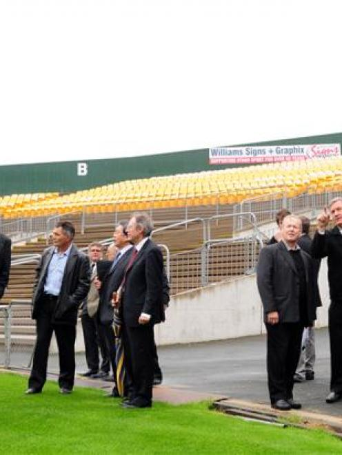 Dunedin City Council finance and corporate support general manager Athol Stephens (second from...