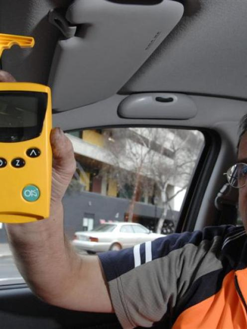 Dunedin City Council meter technician Paul Johnson demonstrates the new SmartPark device in...