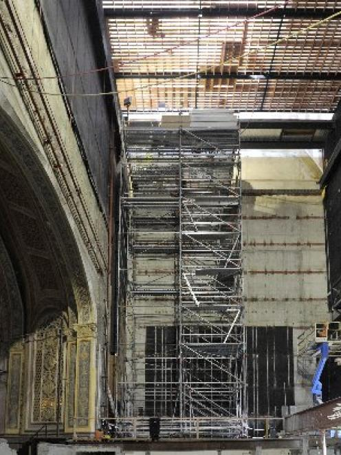 Dunedin City Council property manager Robert Clark on a stripped-out Regent Theatre stage. Photo...