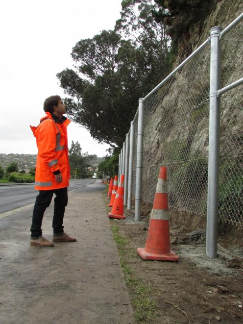 Dunedin City Council senior contract engineer Chris Hasler checks  the cliff wall in  Shore St,...