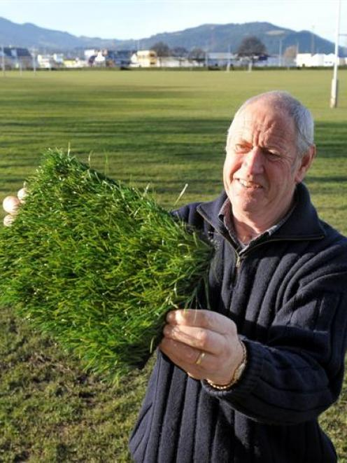 Dunedin City Council sports fields facilities officer Harold Driver displays a sample of...