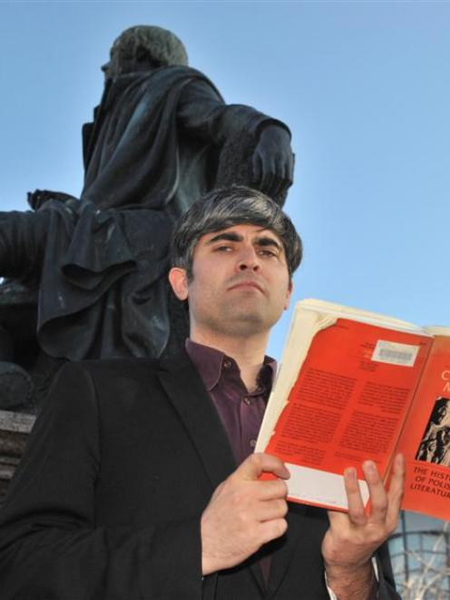 Dunedin City councillor Aaron Hawkins with Czeslaw Milosz's The History of Polish Literature in...