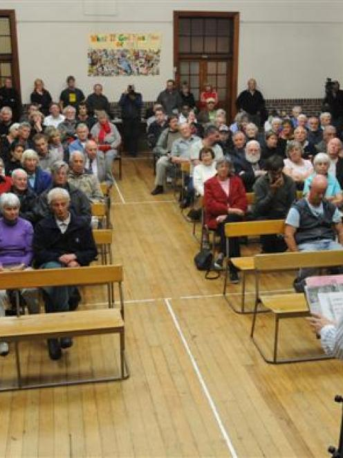 Dunedin city councillor Neil Collins speaks at the Stop the Stadium meeting at the Caversham...