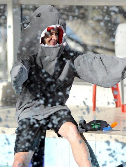 Dunedin diving instructor Chris Zinsli prepares to take part in a marathon swimming event to...