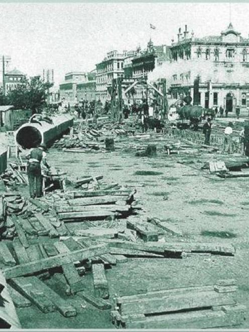 Dunedin Drainage Board workers lay the intercepting sewer along Cumberland St near what is now...